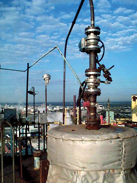 A MOGAS valve sits atop a major refinery tower.